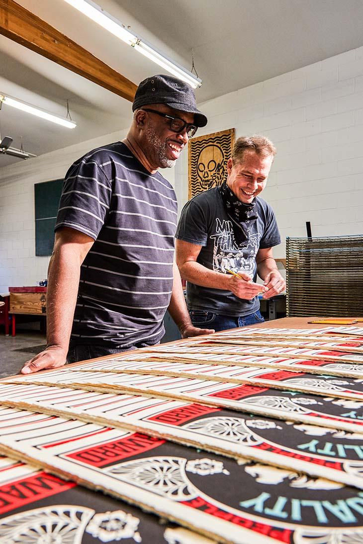 Robert Poulton and Shepard Fairey checking out their print run of 'Push Forward.'