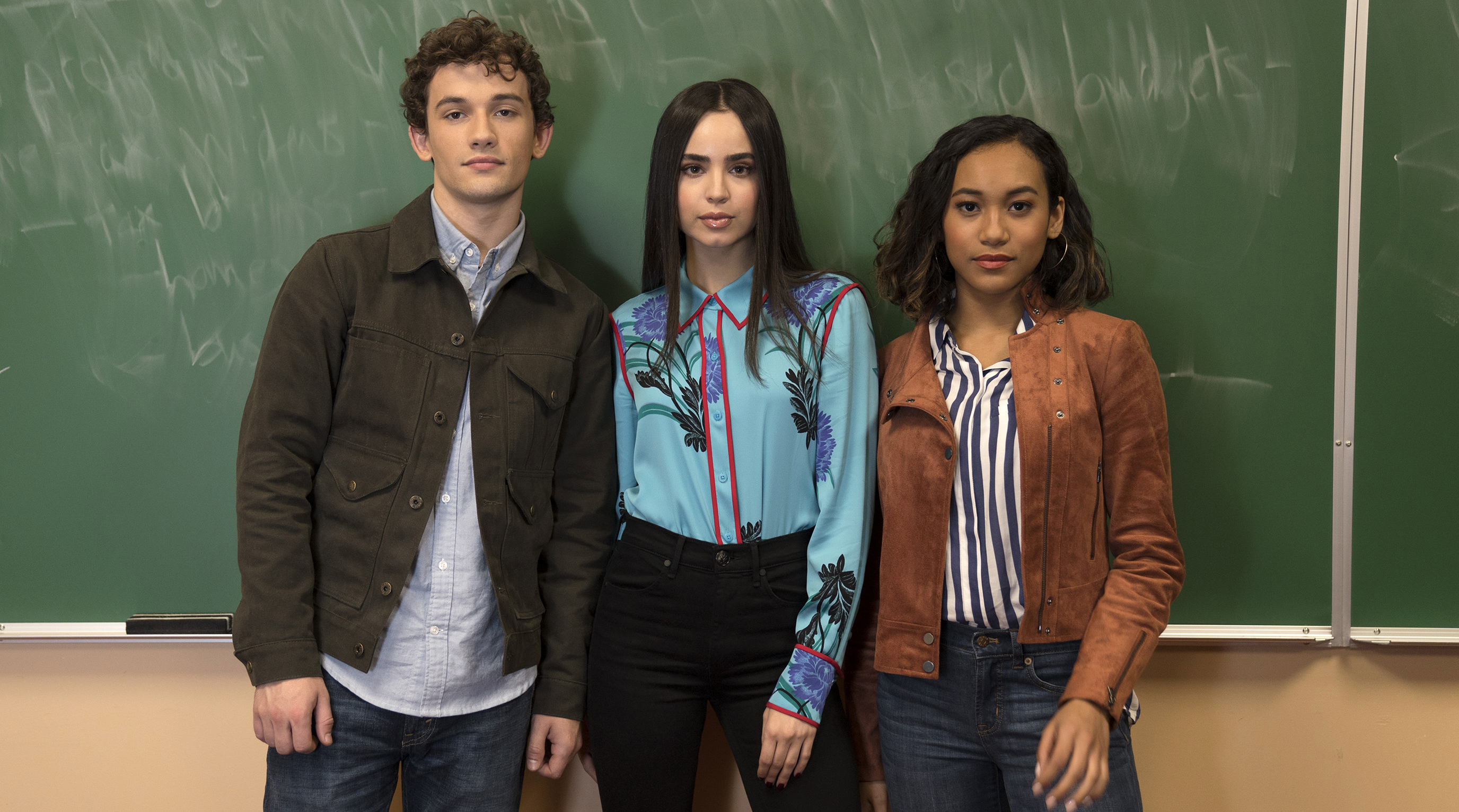 "Freeform's ""Pretty Little Liars: The Perfectionists"" stars Eli Brown as Dylan, Sofia Carson as Ava, and Sydney Park as Caitlyn. [Freeform/Allyson Riggs]"